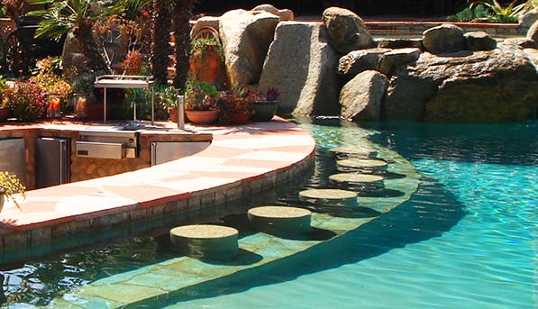 5 epic improvements to your backyard home purewow national for Pool design hamilton