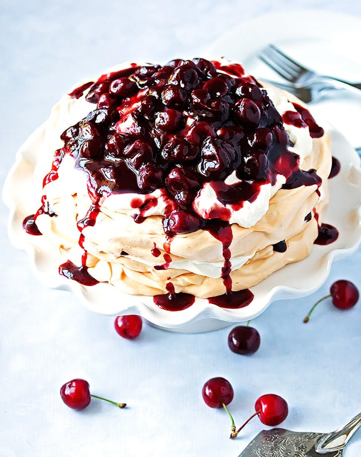 14 delicious wine infused dessert recipes purewow pavlova with red wine cherry compote forumfinder