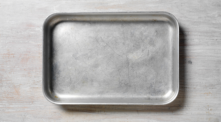 How to remove stains from non-stick cookie sheet