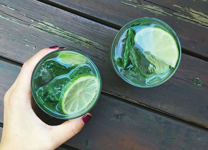 bartender drinks mojito