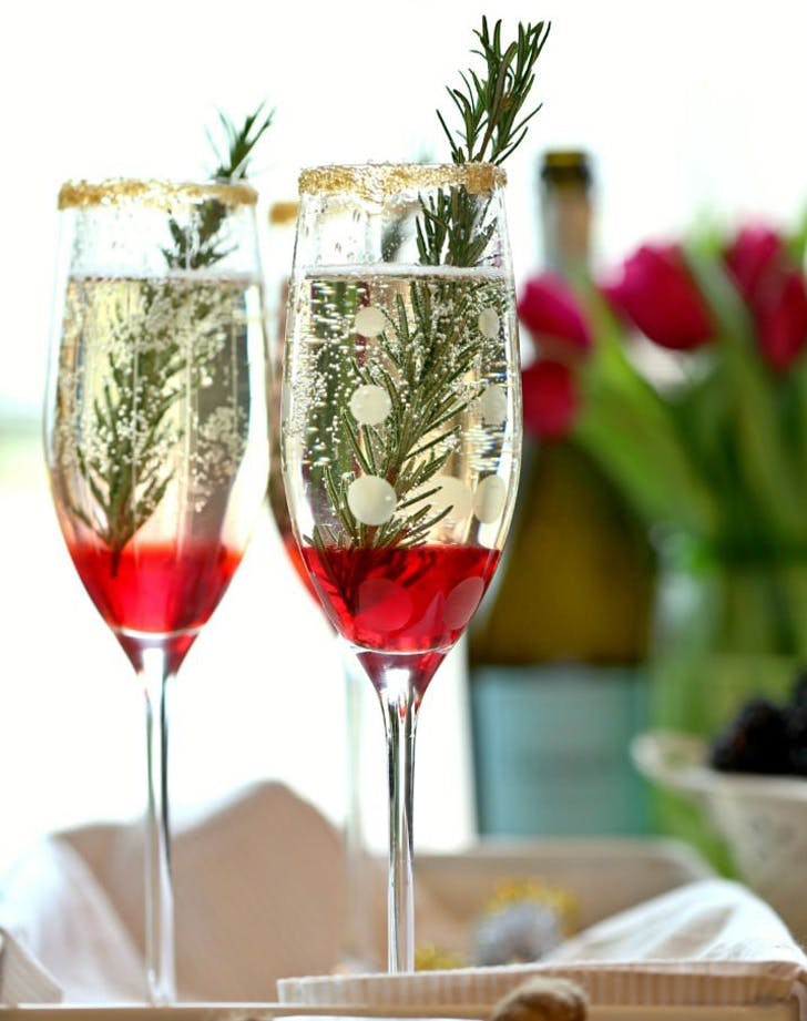 15 festive champagne cocktail recipes purewow for Champagne mixed drinks