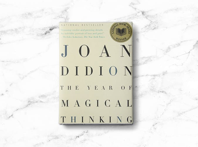 woman books magical thinking