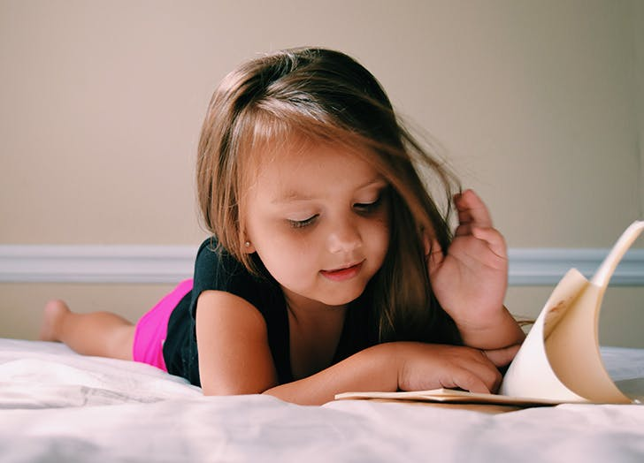 child reading girl