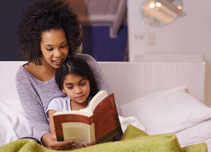 child reading mom girl