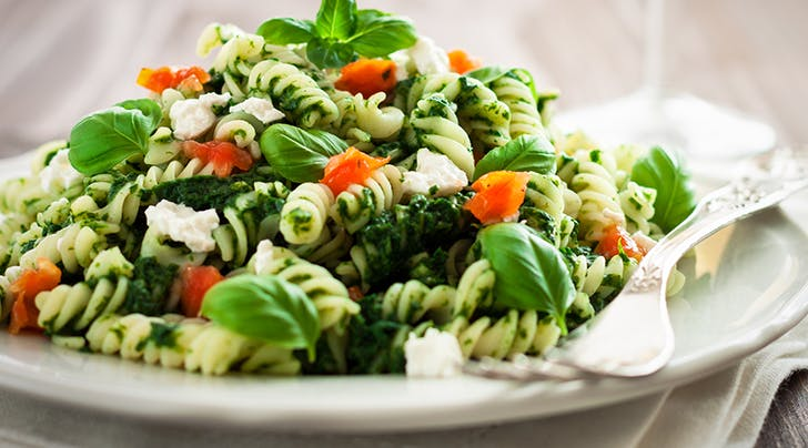 Whole Grain Pasta with Pesto, Mozzarella, Pine Nuts and Tomato