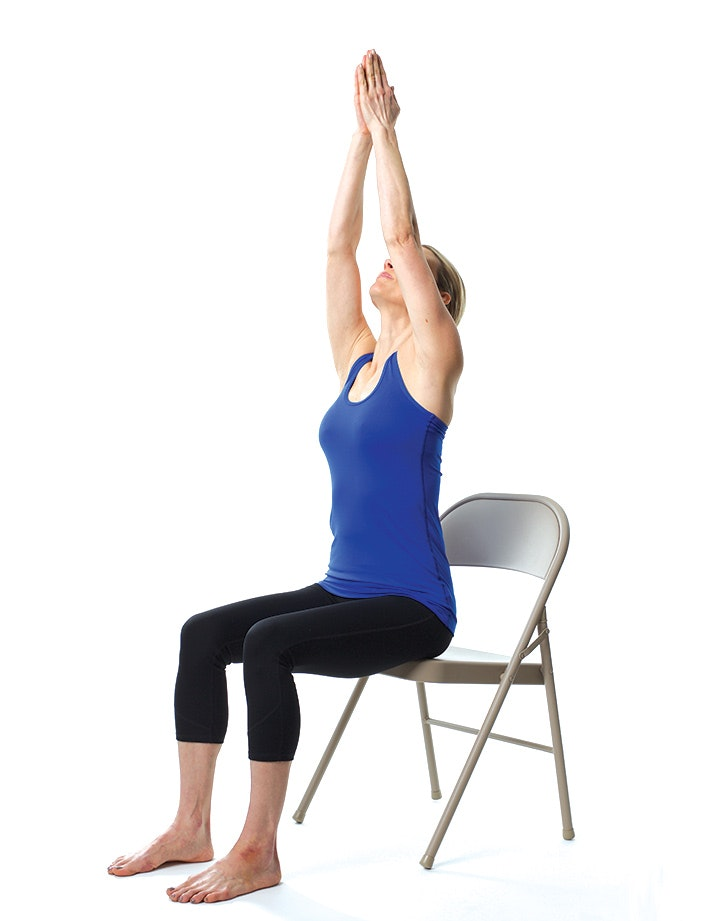picture about Chair Yoga for Seniors Printable called 12 Chair Yoga Poses for Worry and Situation - PureWow