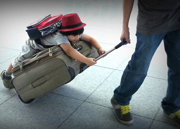 Child on suitcase