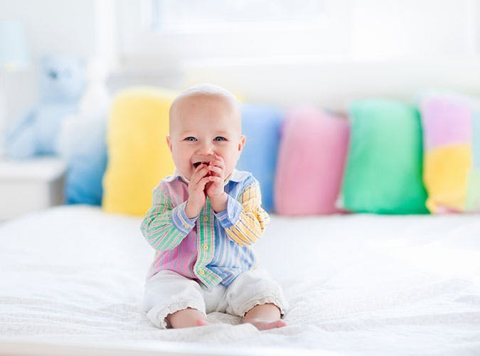 Cute baby in colorful shirt