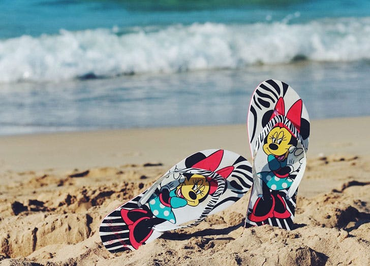 Disney flip flops in the sand