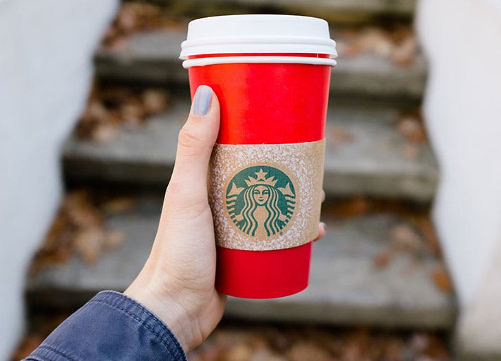 Hand holding a Starbucks up