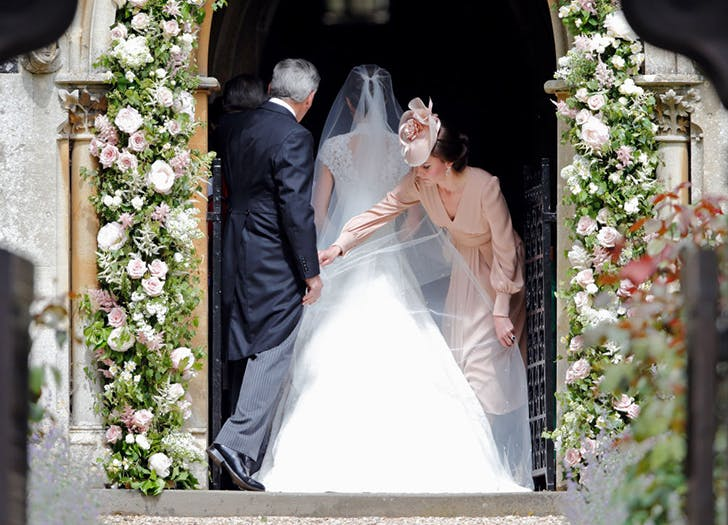 Kate Middleton Fluffing Pippa MIddleton s Wedding Dress