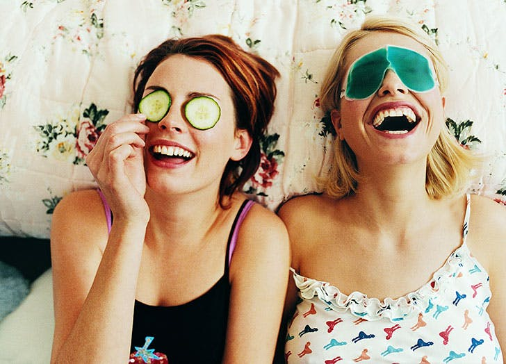 Two women laughing with face masks on