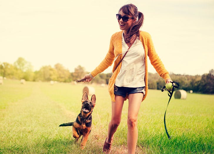 Woman playing with her puppy outdoors