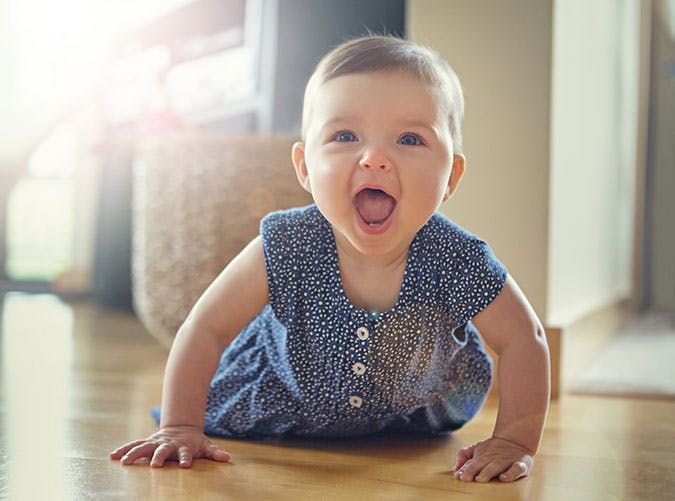 Young baby girl crawling on floor