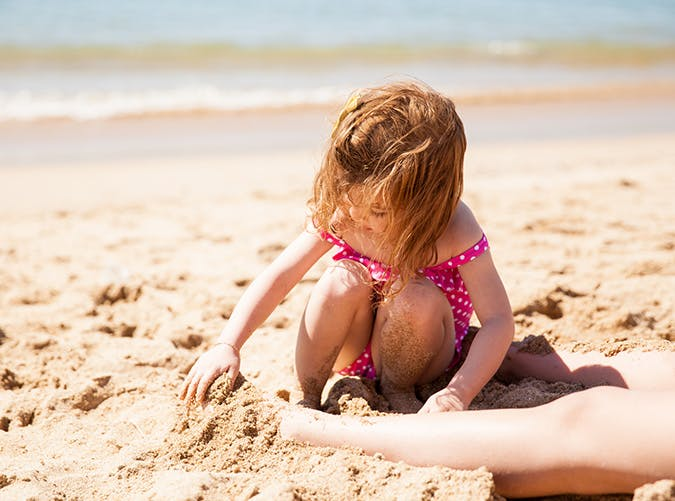 summer kids bury sand