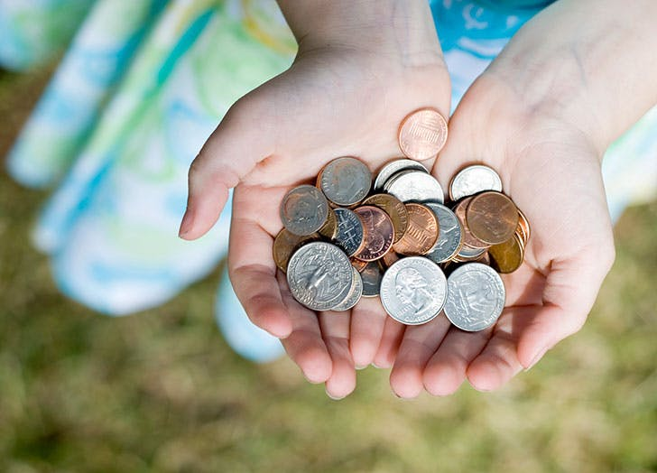 Child s hands holding out coins