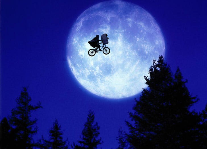 E.T. The extra terrestrial flying over the moon