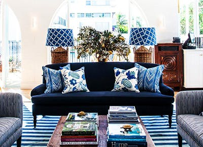 Remarkable Navy And Rattan Decor Is Trending In 2017 Purewow Home Interior And Landscaping Transignezvosmurscom