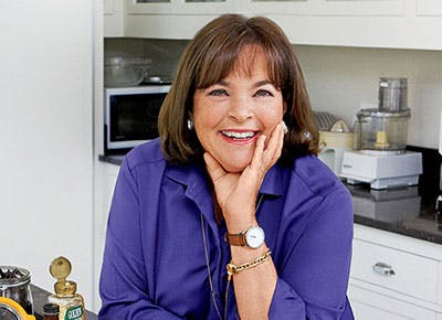 Ina Garten cooking and smiling in kitchen 400
