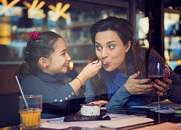 Mom eating with her child at a restaurant