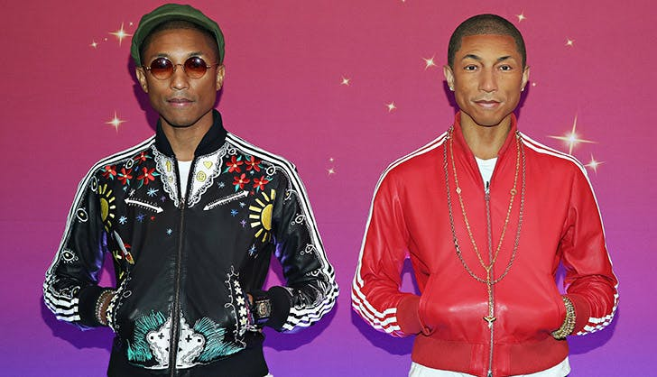 Pharrell Williams Posing with Wax Figure