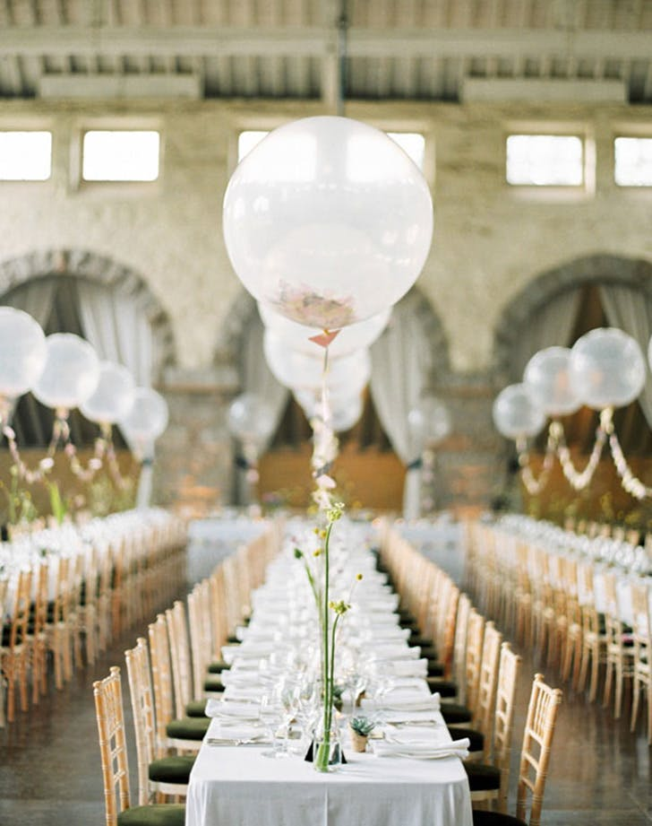 Balloons are our favorite wedding decor trend purewow balloon wedding decor 1 junglespirit Gallery