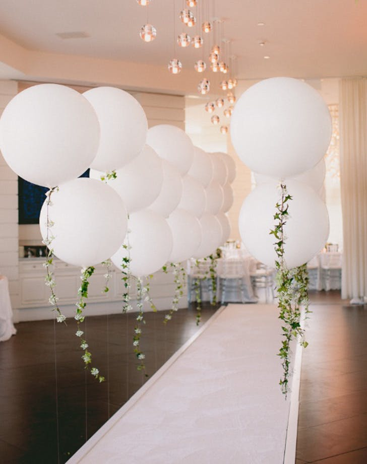 Balloons are our favorite wedding decor trend purewow instead of a grand floral entryway junglespirit Choice Image