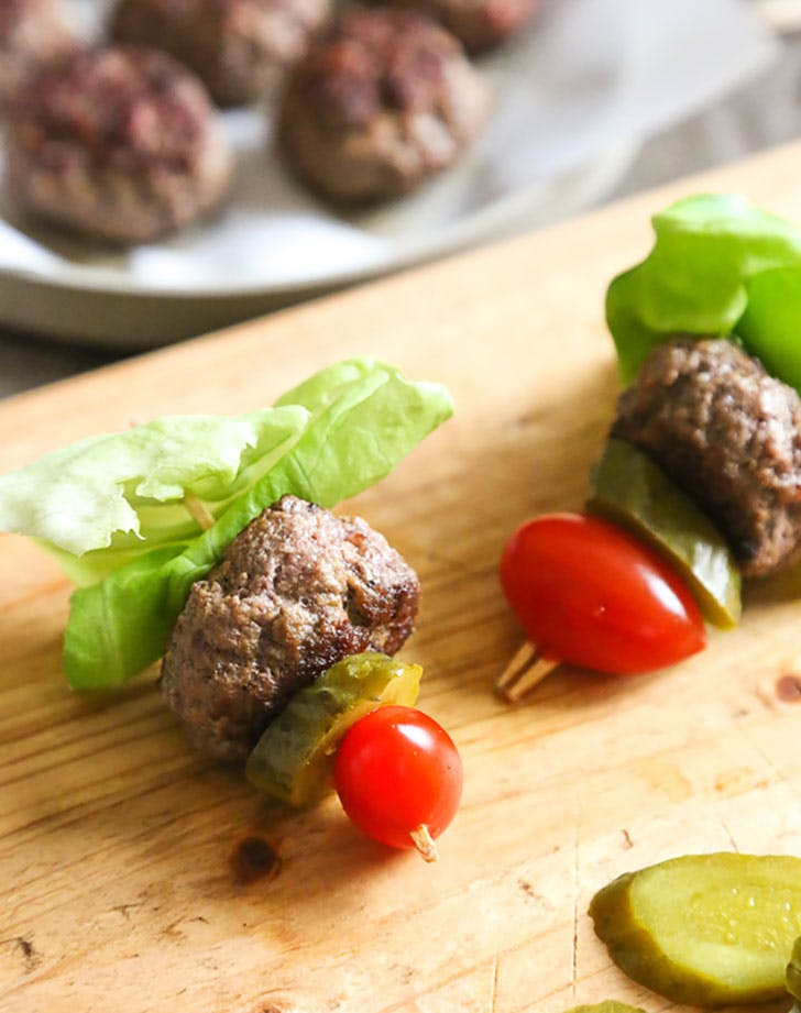 burger bites with tomato and pickles