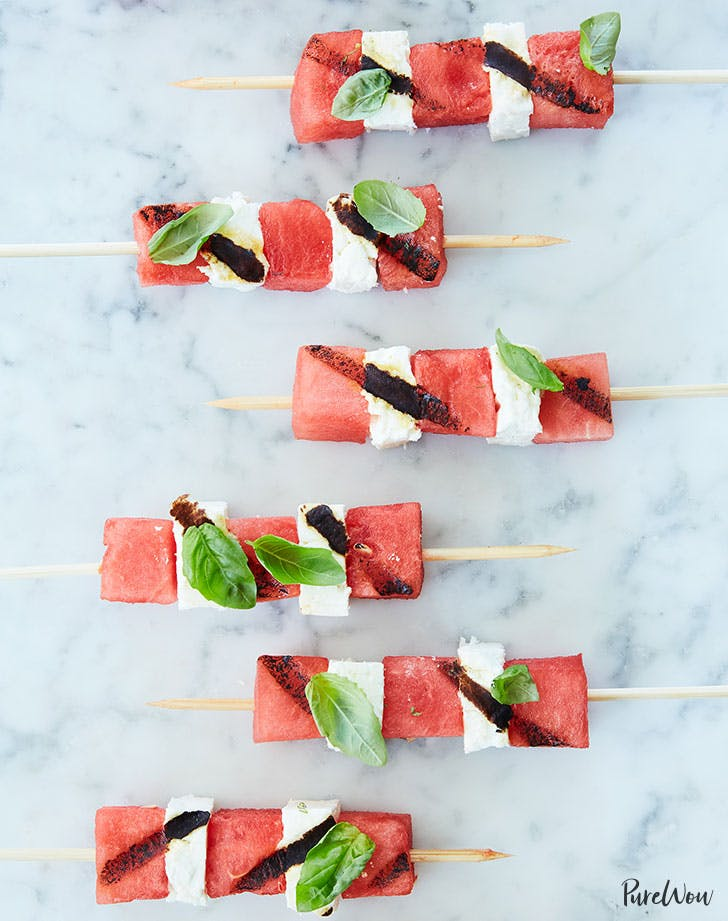grilled watermelon and feta skewers on white background