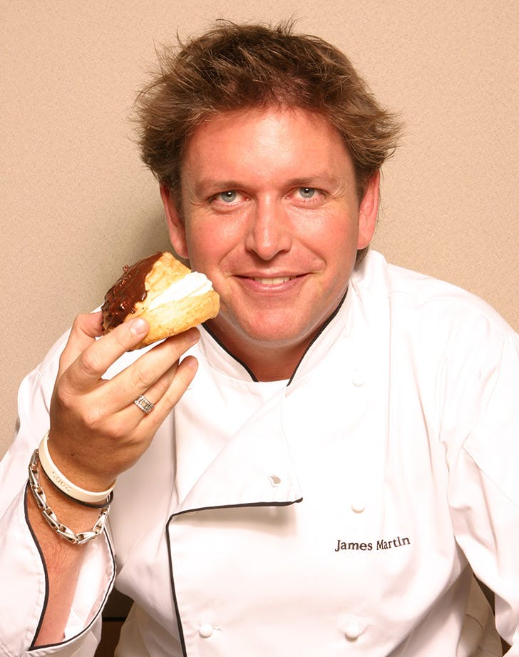 British chef James Martin eating an eclaire