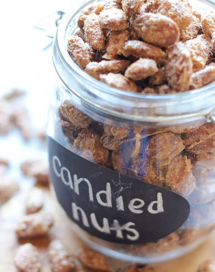 Candied almonds and pecans in a glass jar