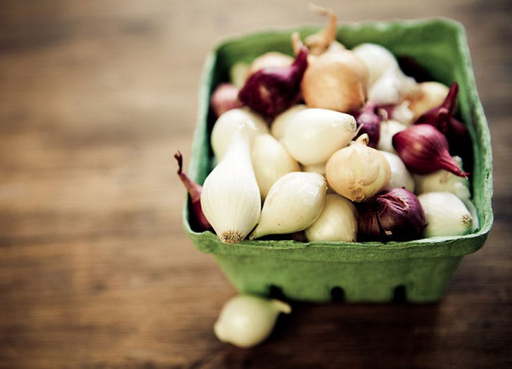 Carton of colorful pearl onions