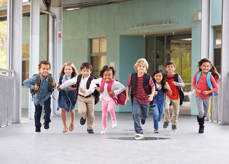 Group of kids running out of school1