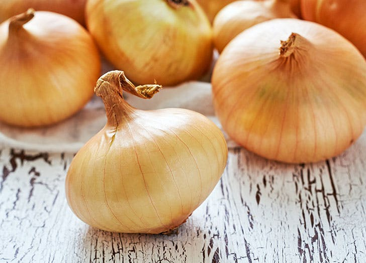 Group of large sweet onions
