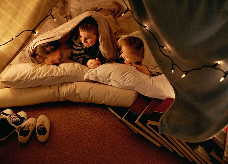 Kids making a fort for a sleepover