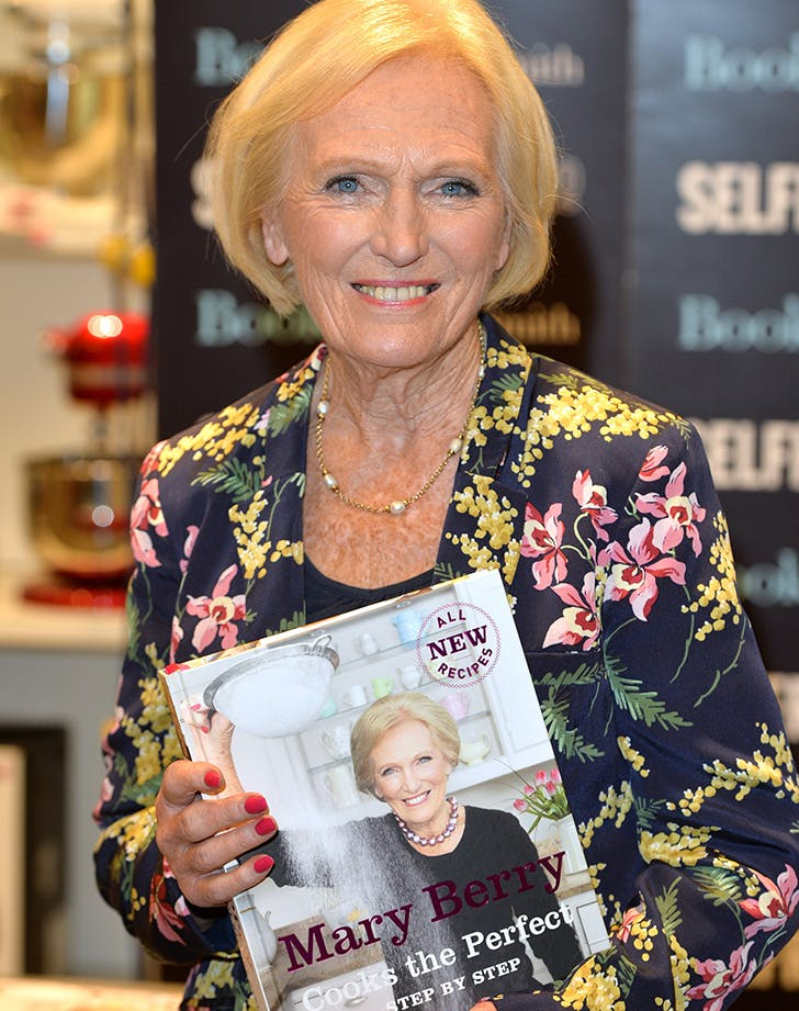 Mary Berry holding her new cookbook