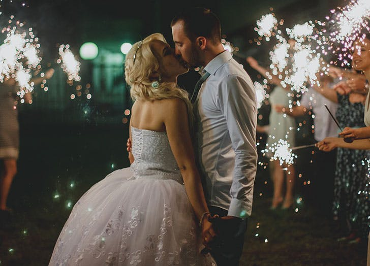 couple kissing sparklers