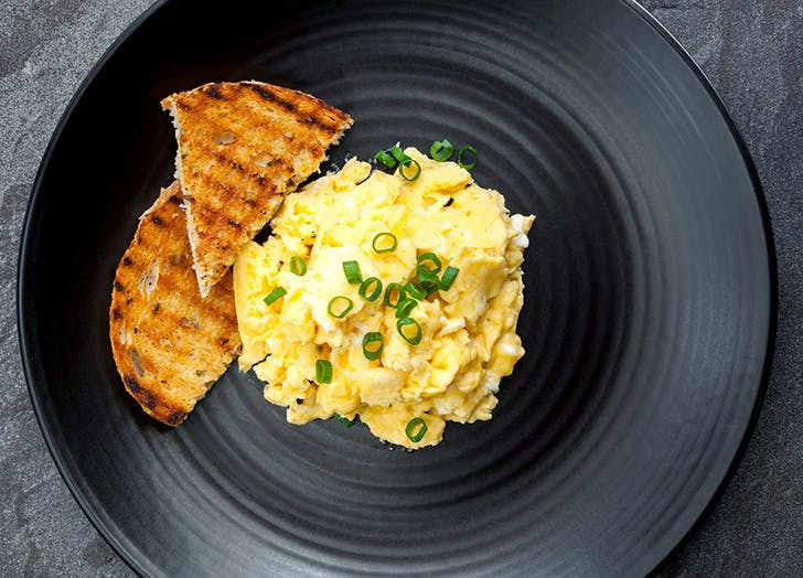 Plate of scrambled eggs with toast