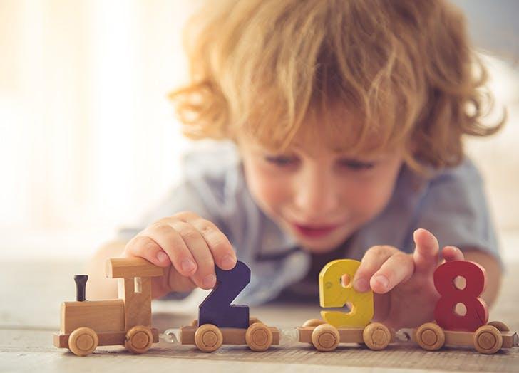 Scottish baby playing with blocks
