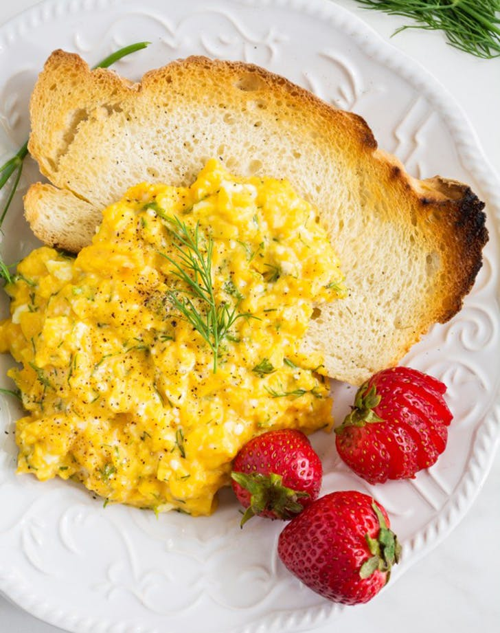 Slow scrambled eggs with dill and feta
