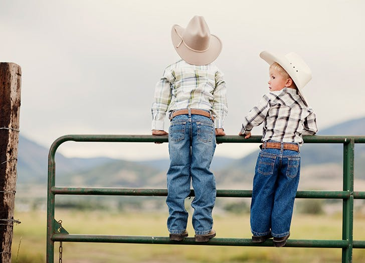 Two young boys on a dude ranch