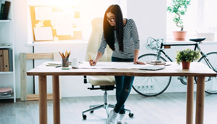 Woman being productive working at desk