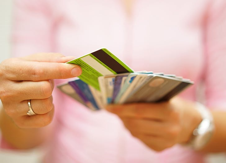 Woman holding a bunch of credit cards