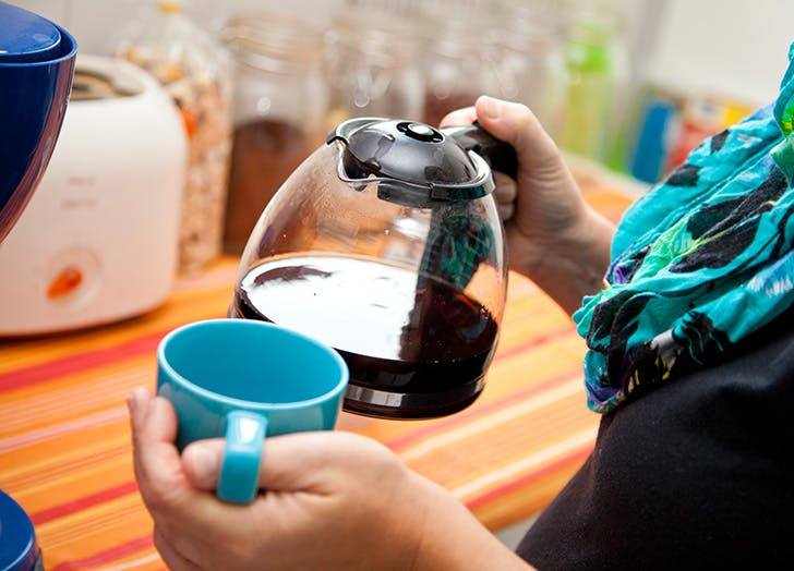 Woman pouring coffee from pot