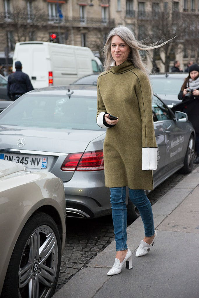 sweater dress over jeans getty images