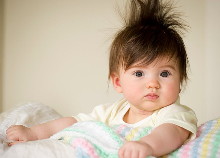Adorable baby with hair sticking up