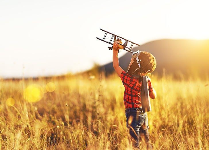 Child pilot aviator playing outside