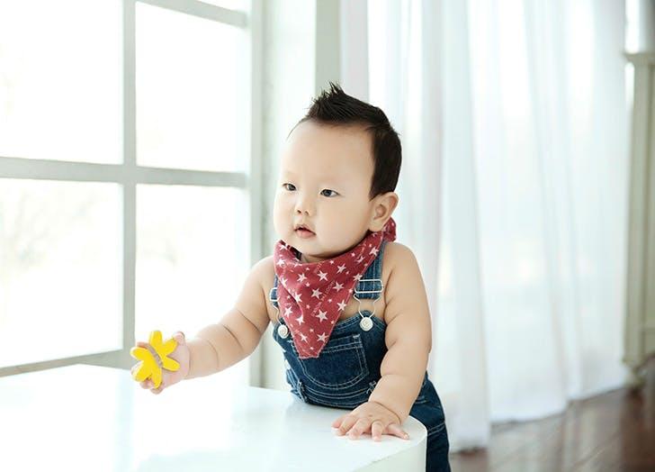Cute baby boy with bandana around his neck