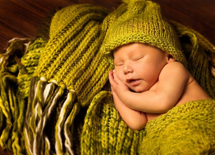 Newborn Baby Sleeping in green blanket