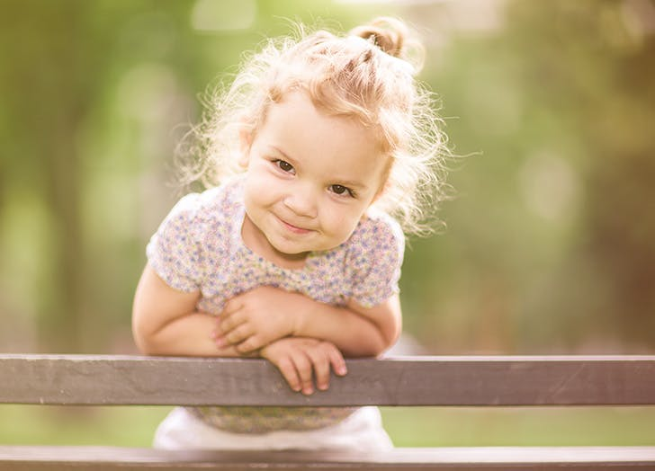 Smiling little girl in the park